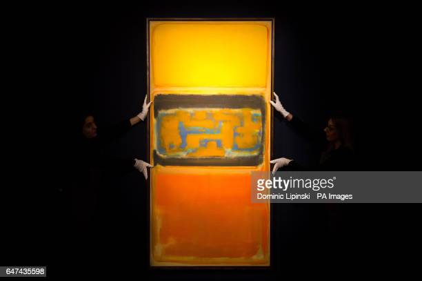Christie's employees adjust No 1 by Mark Rothko which is part of their PostWar and Contemporary art auction on March 9th