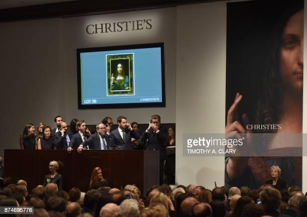 Christie's employees take bids for Leonardo da Vincis 'Salvator Mundi' at Christie's New York November 15 2017 A 500yearold work of art depicting...