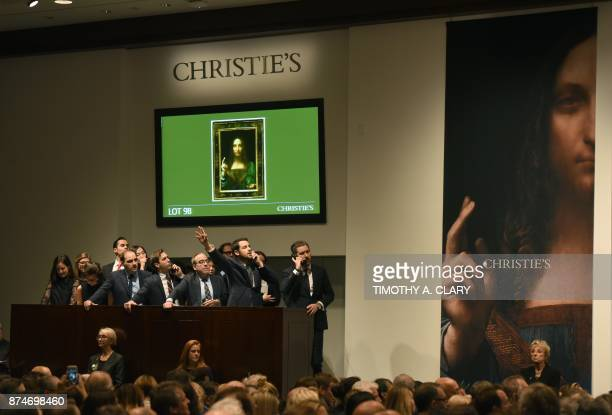 Christie's employees take bids for Leonardo da Vincis Salvator Mundi at Christie's New York on November 15 2017 A 500yearold work of art depicting...