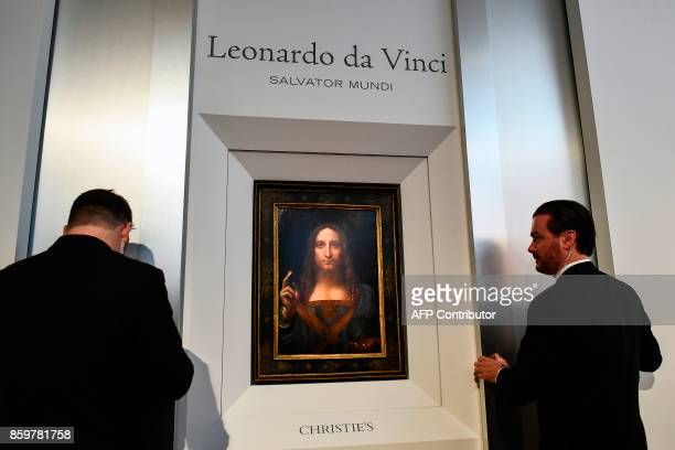 Christie's employees unveil Leonardo da Vinci's Salvator Mundi in New York on October 10 2017 One of fewer than twenty painting by Leonardo da Vinci...