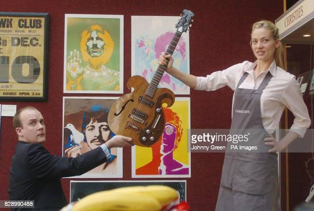 Christie's intern Annika Murjahn from Freiburg in Germany and Christie's Rik Pike prepare to pose up with a custommade Vox Kensington guitar given to...