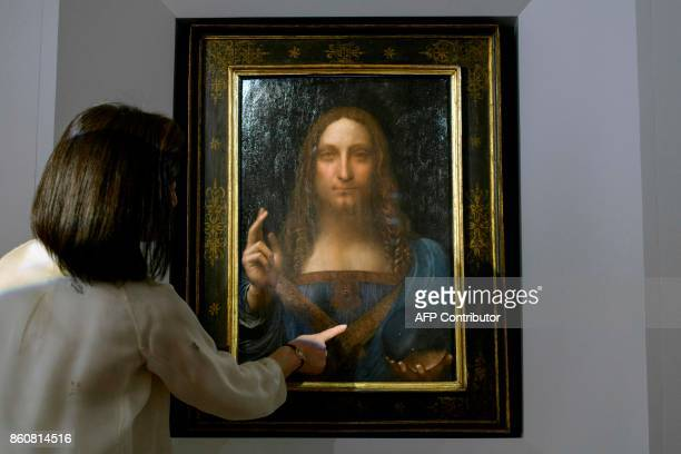 A Christies representative speaks after Leonardo da Vinci's 'Salvator Mundi' painting was unveiled in Hong Kong on October 13 2017 / AFP PHOTO /...