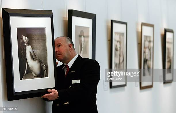 Christies' security guard checks the back of photograph 'Kate Moss New York April 25 1996' by Irving Penn on Monday 10 2008 in London England The...
