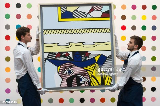 Christies staff hold a painting titled Two Paintings With Dado by artist Roy Lichtenstein with a sale estimate of £2000£3000 in London United Kingdom...