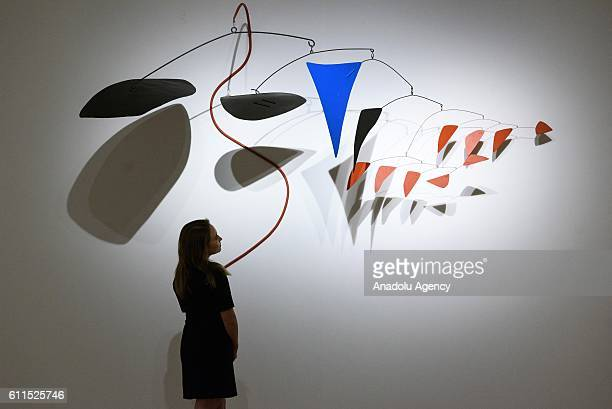 Christies staff views artwork titled Le Serpent rouge by artist Alexander Calder with an auction estimate of £2000£3000 on September 30 2016 in...