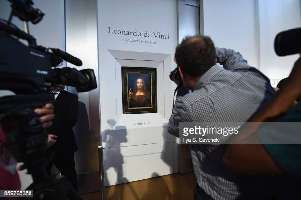 Christie's unveils Leonardo da Vinci's 'Salvator Mundi' with Andy Warhol's 'Sixty Last Suppers' at Christie's New York on October 10 2017 in New York...