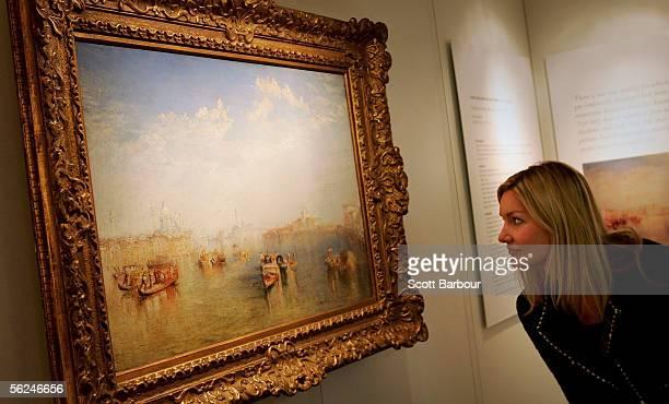 Christie's worker examines JMW Turner's masterpiece 'Giudecca La Donna della Salute and San Giorgio' at Christie's auction house on November 21 2005...