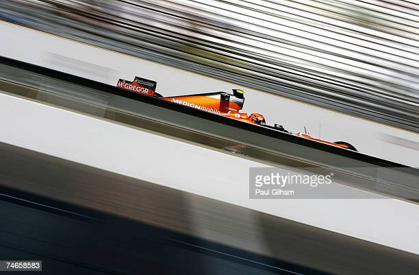 Christijan Albers of The Netherlands and Spyker F1 practices prior to qualifying for the F1 Grand Prix of USA at the Indianapolis Motor Speedway on...