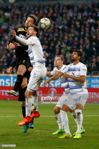 Christin Beck of Magdeburg and Dustin Bomheuer of Duisburg go up for a header during the Third League match between MSV Duisburg and 1 FC Magdeburg...