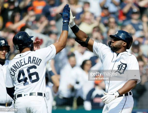Christin Stewart of the Detroit Tigers celebrates with Jeimer Candelario after hitting a grand slam against the Kansas City Royals during the seventh...