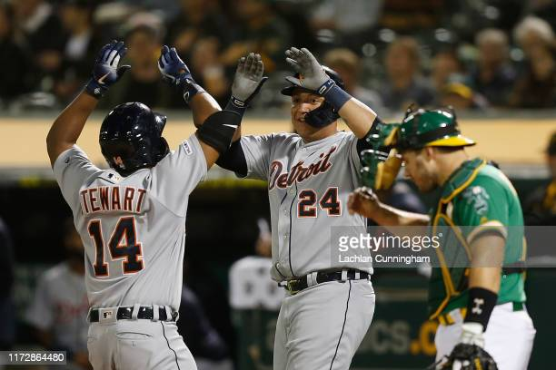 Christin Stewart of the Detroit Tigers celebrates with Miguel Cabrera after hitting a two-run home run in the top of the seventh inning against the...