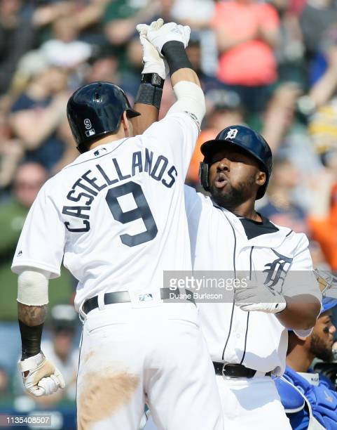 Christin Stewart of the Detroit Tigers celebrates with Nicholas Castellanos of the Detroit Tigers after hitting a grand slam against the Kansas City...