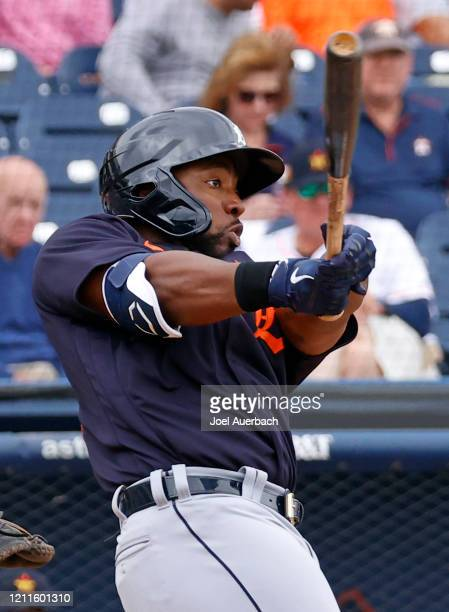 Christin Stewart of the Detroit Tigers hits the ball against the Houston Astros during a spring training game at The Ballpark of the Palm Beaches on...