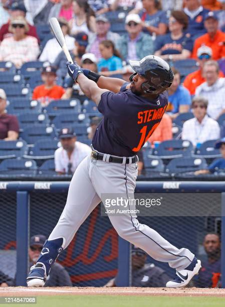 Christin Stewart of the Detroit Tigers hits the ball against the Houston Astros during a spring training game at the FITTEAM Ballpark of the Palm...