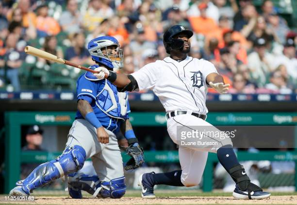 Christin Stewart of the Detroit Tigers right watches his seventh inning grand slam with catcher Martin Maldonado of the Kansas City Royals at...