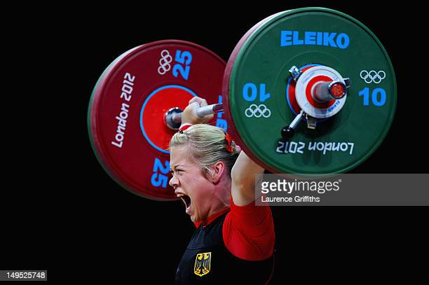 Christin Ulrich of Germany reacts while competing in the Women's 58kg Weightlifting on Day 3 of the London 2012 Olympic Games at ExCeL on July 30...