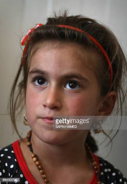 Christina a sixyearold Iraqi Christian girl gazes during a meeting with her family in Ashti 2 camp for displaced Christians in Arbil the capital of...