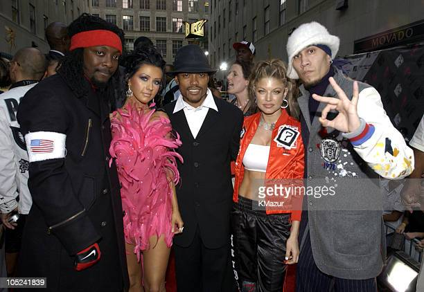 Christina Aguilera and Black Eyed Peas during 2003 MTV Video Music Awards Red Carpet at Radio City Music Hall in New York City New York United States