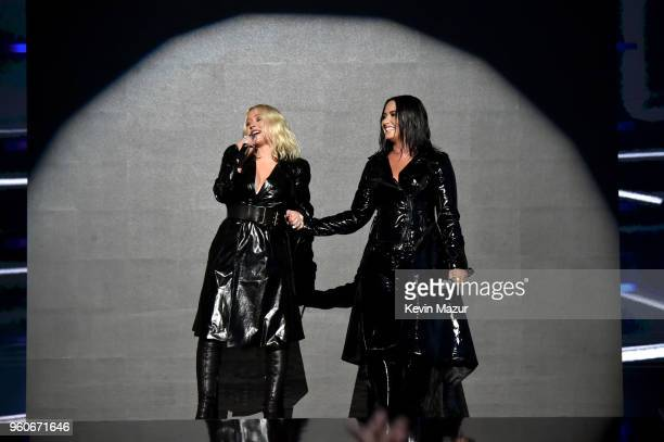 Christina Aguilera and Demi Lovato perform onstage duirng the 2018 Billboard Music Awards at MGM Grand Garden Arena on May 20 2018 in Las Vegas Nevada