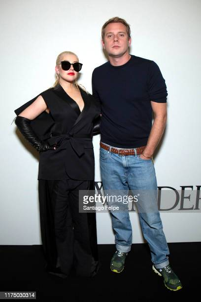 Christina Aguilera and designer Jonathan Anderson pose for photos backstage after 'JW Anderson S/S 2020' fashion show during London Fashion Week...