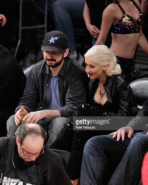 Christina Aguilera and her husband Jordan Bratman attend Game Six of the NBA playoff finals between the Boston Celtics and the Los Angeles Lakers...