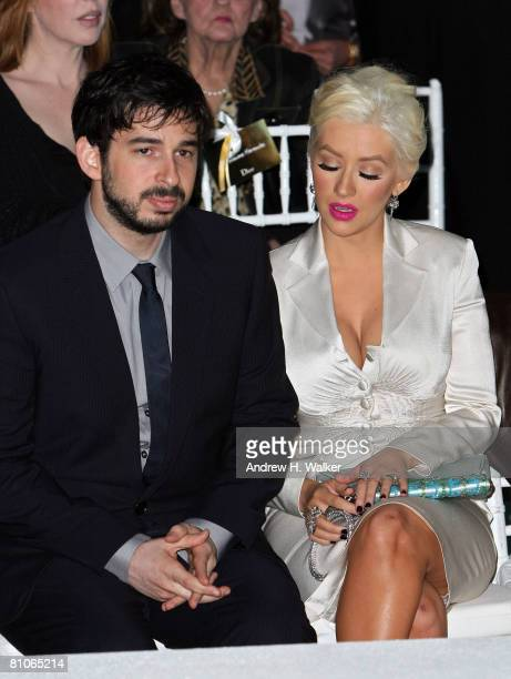 Christina Aguilera and her husband Jordan Bratman attend the Christian Dior Cruise 2009 Collection at Gustavino's in New York City