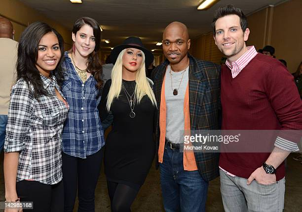 Christina Aguilera and her team from The Voice including Ashley De La Rosa Lindsey Pavao Jesse Campbell and Chris Mann visit the Crenshaw High School...