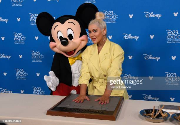 Christina Aguilera and Micky Mouse attend D23 Disney Legends event at Anaheim Convention Center on August 23 2019 in Anaheim California