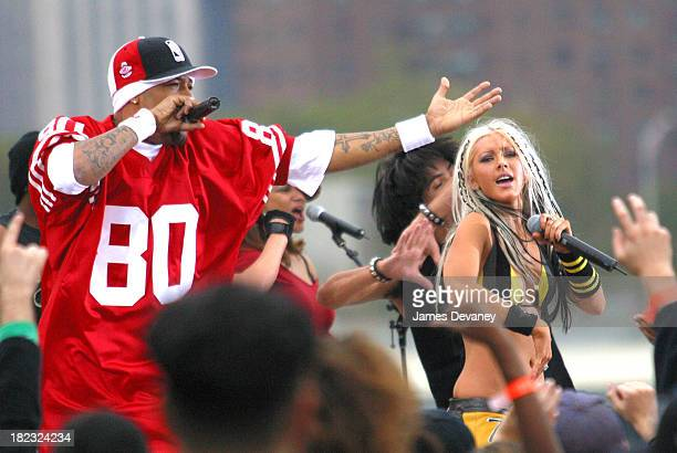 Christina Aguilera and Redman during Christina Aguilera Performs at the Brooklyn Bridge at Empire Fulton State Park in Brooklyn New York United States