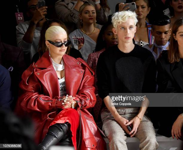 Christina Aguilera and Troye Sivan attend the Christian Cowan Front Row during New York Fashion Week The Shows at Gallery II at Spring Studios on...