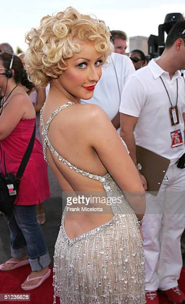 Christina Aguilera arrives at the 2004 MTV Video Music Awards at the American Airlines Arena August 29 2004 in Miami Florida