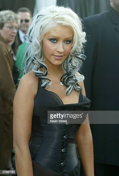 Christina Aguilera arrives at the 30th Annual AMAs held at the Shrine Auditorium in Los Angeles CA January 13 2003 Photo by Kevin Winter/ABC/Getty...