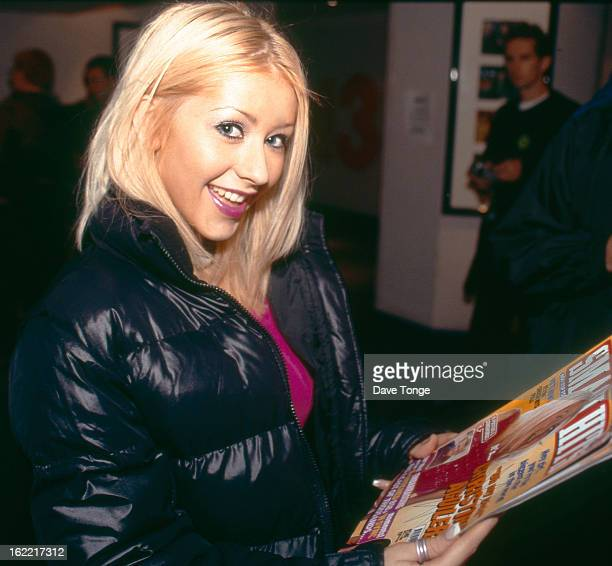 Christina Aguilera holds a copy of Smash Hits magazine backstage at a TV studio London circa 1999