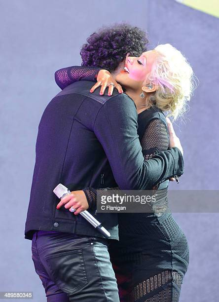 Christina Aguilera joins Ian Axel of A Great Big World onstage during the KIIS FM's 2014 Wango Tango at StubHub Center on May 10 2014 in Los Angeles...