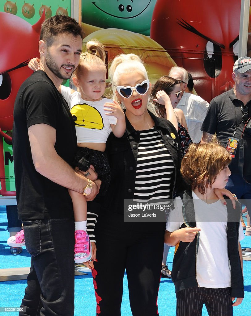 Christina Aguilera, Matthew Rutler, Max Liron Bratman and Summer Rain Rutler attend the premiere of 'The Emoji Movie' at Regency Village Theatre on July 23, 2017 in Westwood, California.