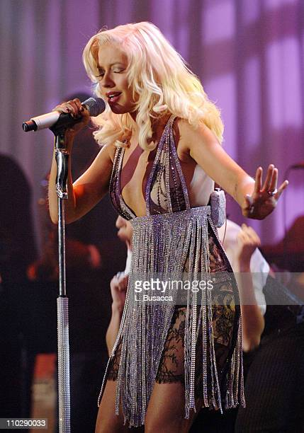 Christina Aguilera performs during 2007 Clive Davis PreGRAMMY Awards Party Show at Beverly Hills Hilton in Beverly Hills California United States