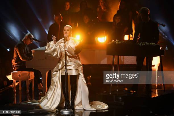 Christina Aguilera performs with Ian Axel and Chad King of A Great Big World onstage during the 2019 American Music Awards at Microsoft Theater on...