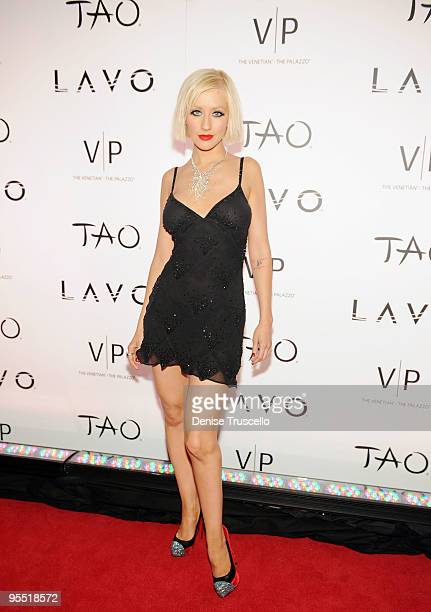 Christina Aguilera poses for photos on the TAO/Lavo red carpet at the Venetian on December 31 2009 in Las Vegas Nevada