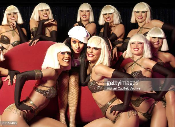Christina Aguilera poses with the girls of La Femme following their performance