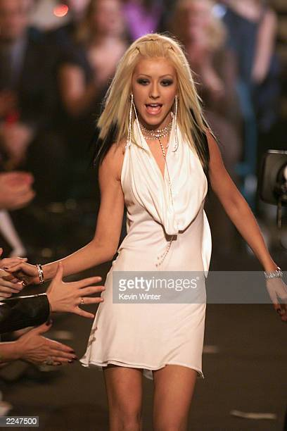 Christina Aguilera shakes fans hands at the 2000 Billboard Music Awards in Las Vegas, Nevada. December 5, 2000