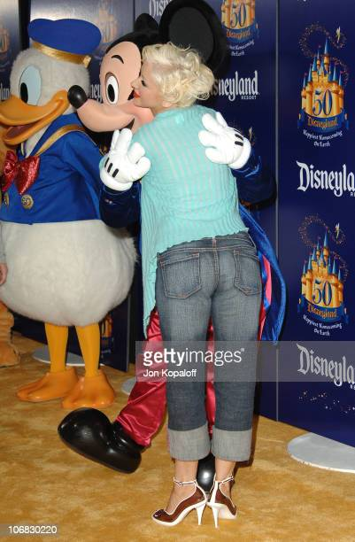 Christina Aguilera with Donald Duck and Mickey Mouse