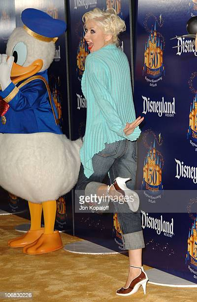 Christina Aguilera with Donald Duck during Disneyland 50th Anniversary Happiest Homecoming on Earth Celebration Arrivals and Fireworks at Disneyland...