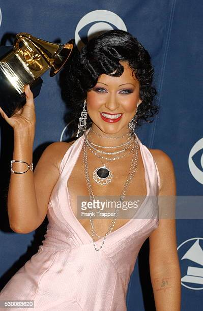 Christina Aguilera with her award for Best Female Pop Vocal Performance in the press room at the 46th annual Grammy Awards