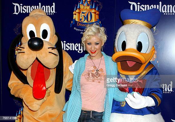 Christina Aguilera with Pluto and Donald Duck at the Disneyland in Anaheim California