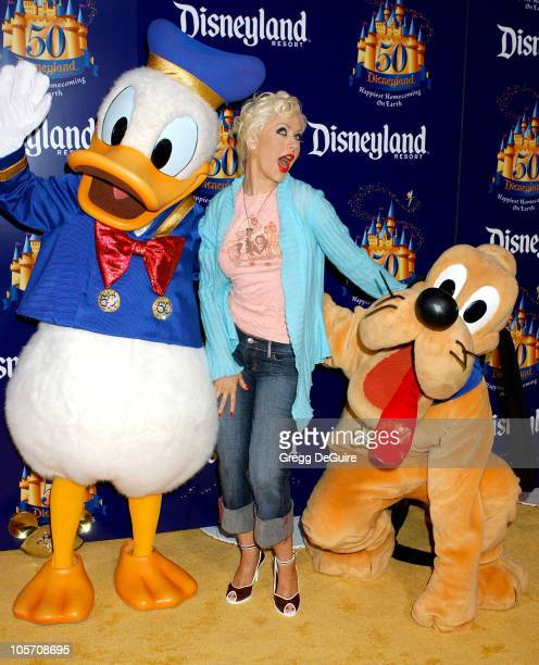 Christina Aguilera with Pluto and Donald Duck during Disneyland 50th Anniversary Happiest Homecoming On Earth Celebration at Disneyland in Anaheim...