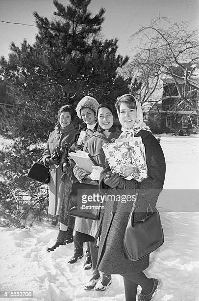 Christina and Classmates Cambridge Mass Carrying Christmas gift packages Princess Christina of Sweden is joined by classmates as they have their...