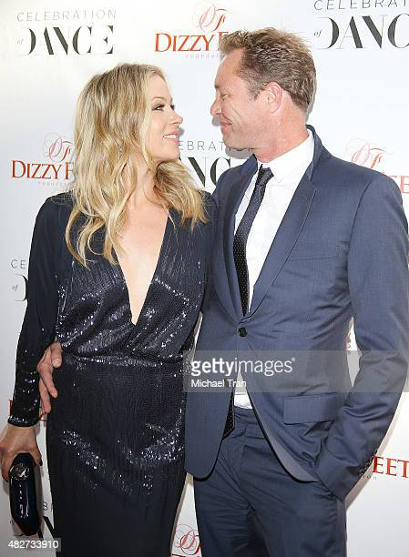 Christina Applegate and her husband Martyn LeNoble arrive at Dizzy Feet Foundation's 5th Annual Celebration Of Dance Gala held at Club Nokia on...