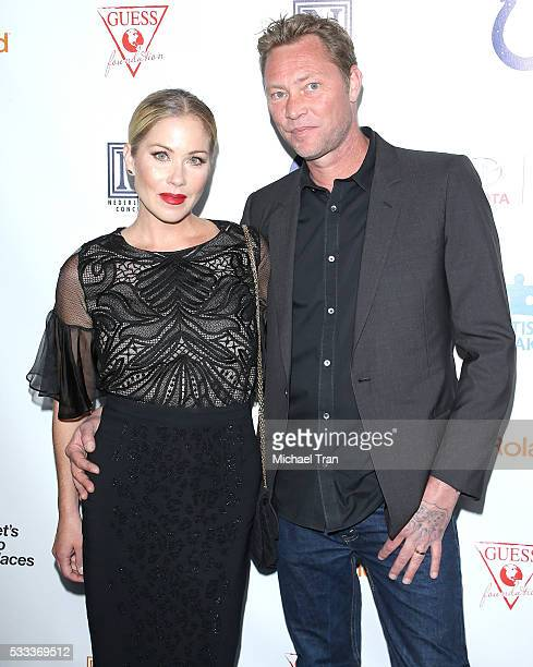 Christina Applegate and Martyn LeNoble arrive at the 4th Annual Light Up The Blues held at the Pantages Theatre on May 21 2016 in Hollywood California