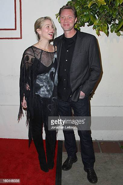 Christina Applegate and Martyn LeNoble attend the Kumpania Flamenco Los Angeles Los Angeles Premiere Arrivals at El Cid on January 31 2013 in Los...