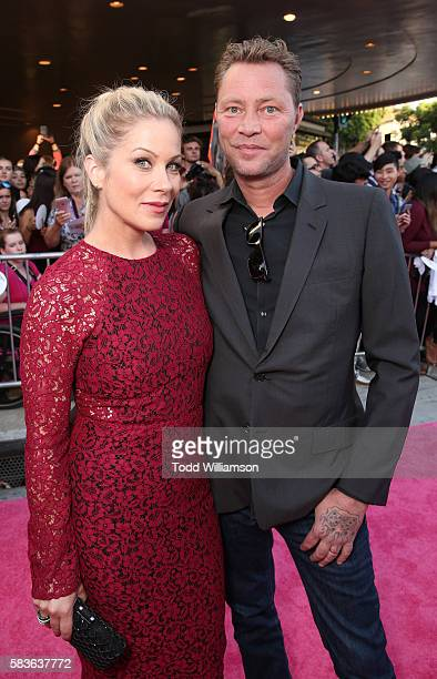 Christina Applegate and Martyn LeNoble attend the premiere Of STX Entertainment's Bad Moms at Mann Village Theatre on July 26 2016 in Westwood...